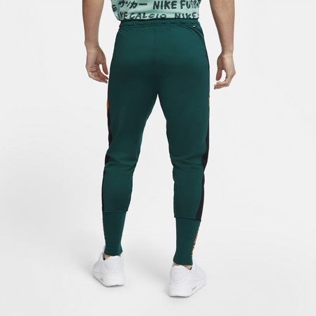 Pantalon survêtement Nike vert orange