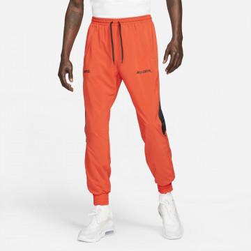 Pantalon survêtement Nike F.C. Joga Bonito orange 2021/22